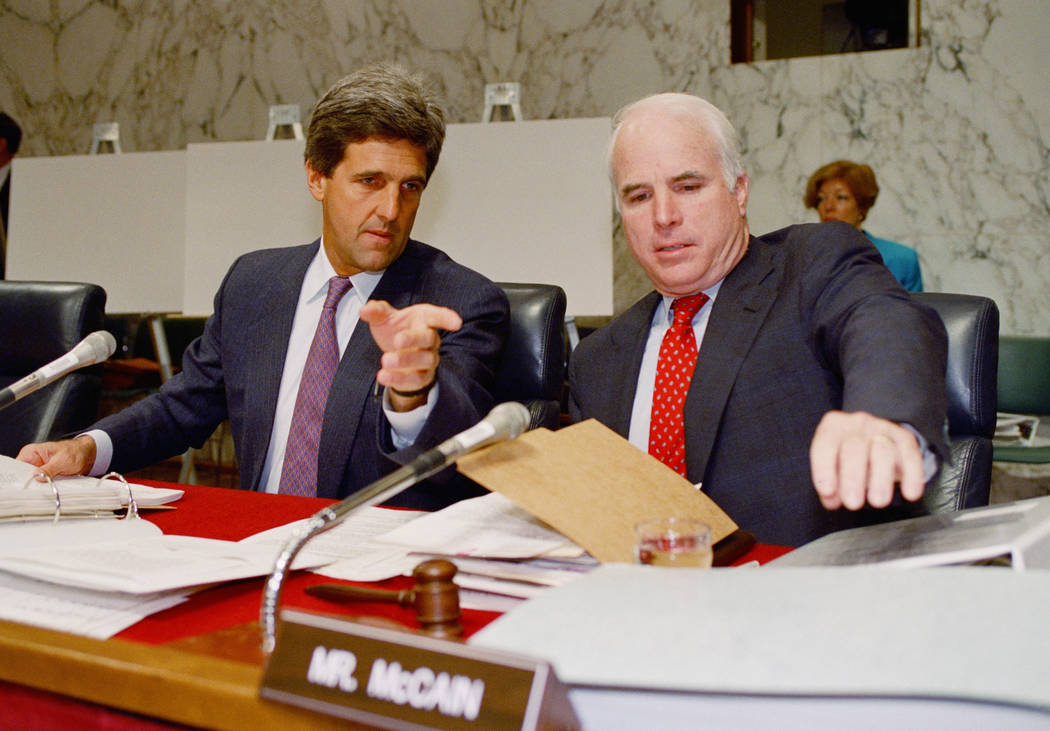 In this June 24, 1992, file photo, Sen. John Kerry, D-Mass, chairman of the Senate POW/MIA Committee, left, gestures while talking to Sen. John, McCain, R-Ariz, a former POW, prior to a hearing of ...