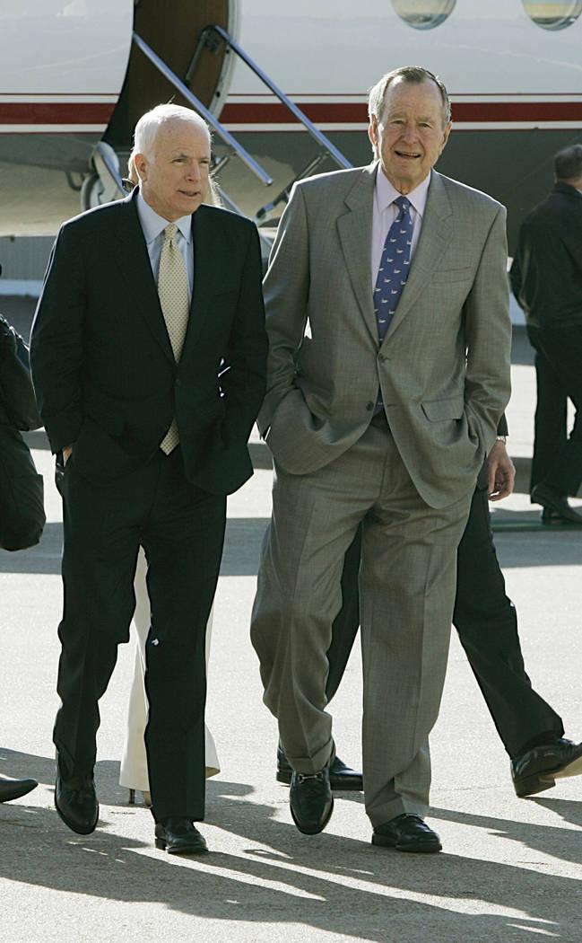 In this Feb. 18, 2008, file photo, former President George Bush, right, and Republican presidential hopeful Sen. John McCain (R-AZ) meet in Houston. (AP Photo/Pat Sullivan)