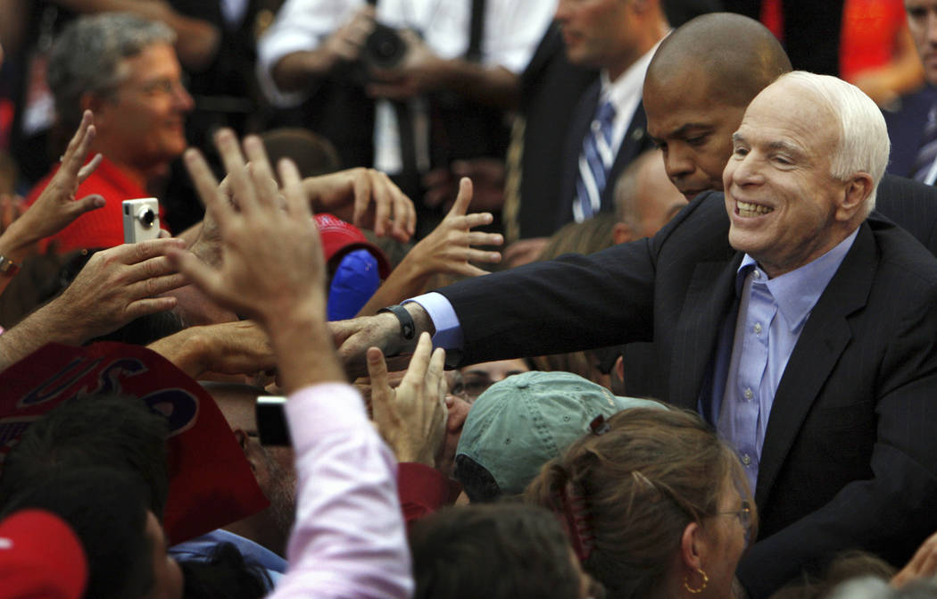 In this Sept. 22, 2008, file photo, Republican presidential candidate Sen. John McCain, R-Ariz., greets supporters after speaking at a campaign rally in Media Pa. (AP Photo/Joseph Kaczmarek)