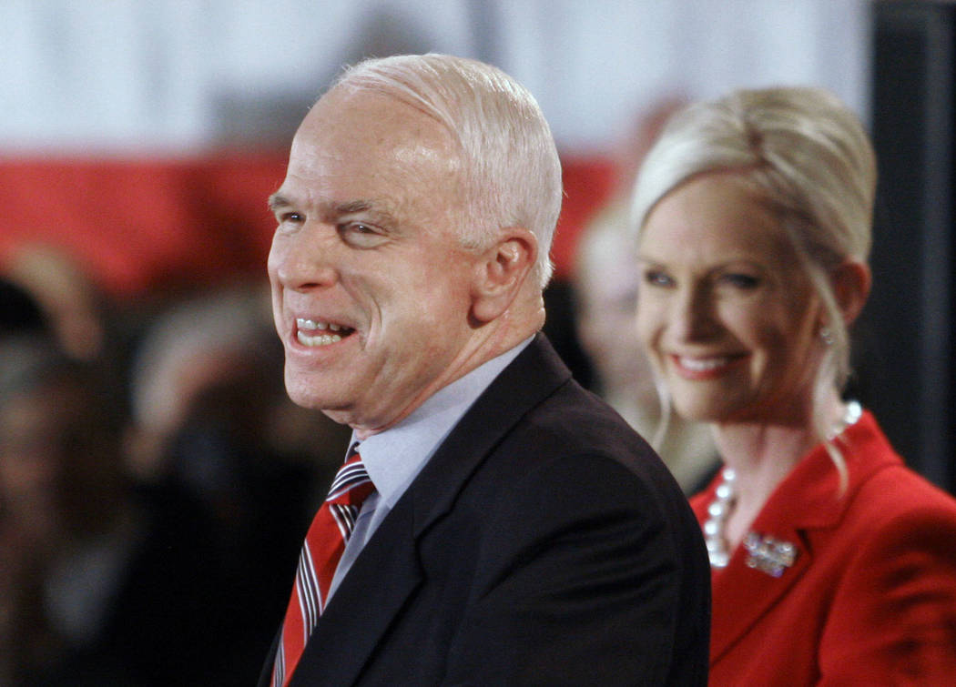 FILE - In this Jan. 8, 2008 file photo, Republican presidential hopeful Sen. John McCain, R-Ariz., with wife Cindy alongside, addresses supporters on election night in Nashua, N.H. McCain's famil ...