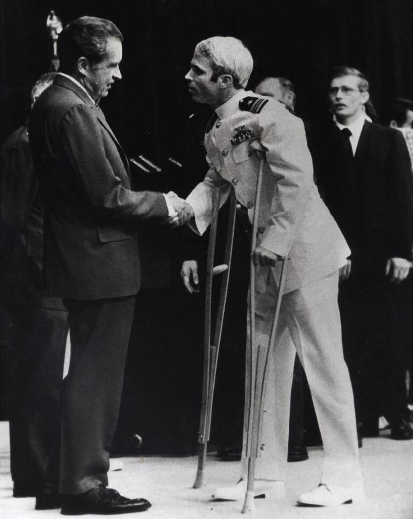 John McCain is greeted by President Richard Nixon, left, in Washington, May 25, 1973. McCain spent more than five years in a Vietnamese prisoner of war camp before he was released in March of 19 ...