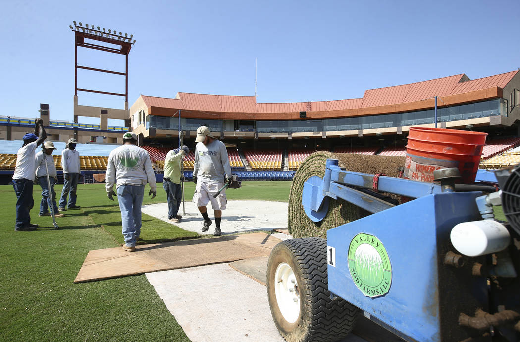 World Sports Solutions International employees lay sod around the pitcher's mound while converting the field from baseball to soccer use ahead of a Lights FC game at Cashman Field in Las Vegas on ...