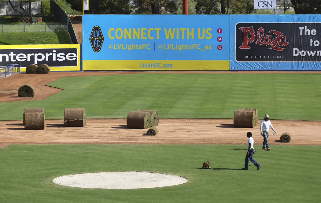 World Sports Solutions International employees work to convert the field from baseball to soccer use ahead of a Lights FC game at Cashman Field in Las Vegas on Friday, Aug. 3, 2018. Chase Stevens ...