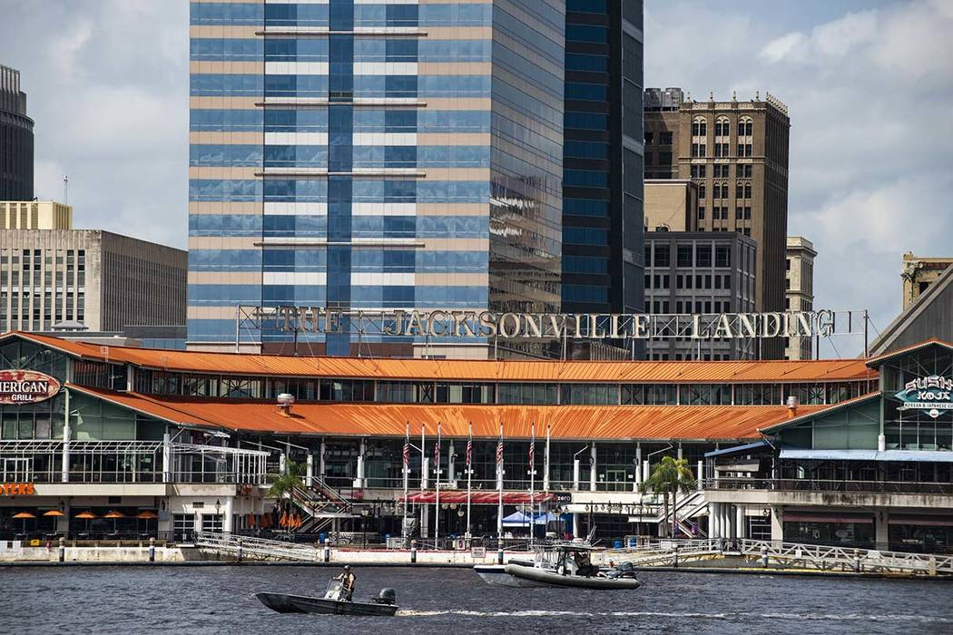 The coast guard patrols the St John's river outside of the Jacksonville Landing in Jacksonville, Fla., Sunday, Aug. 26, 2018. Florida authorities are reporting multiple fatalities after a mass sho ...