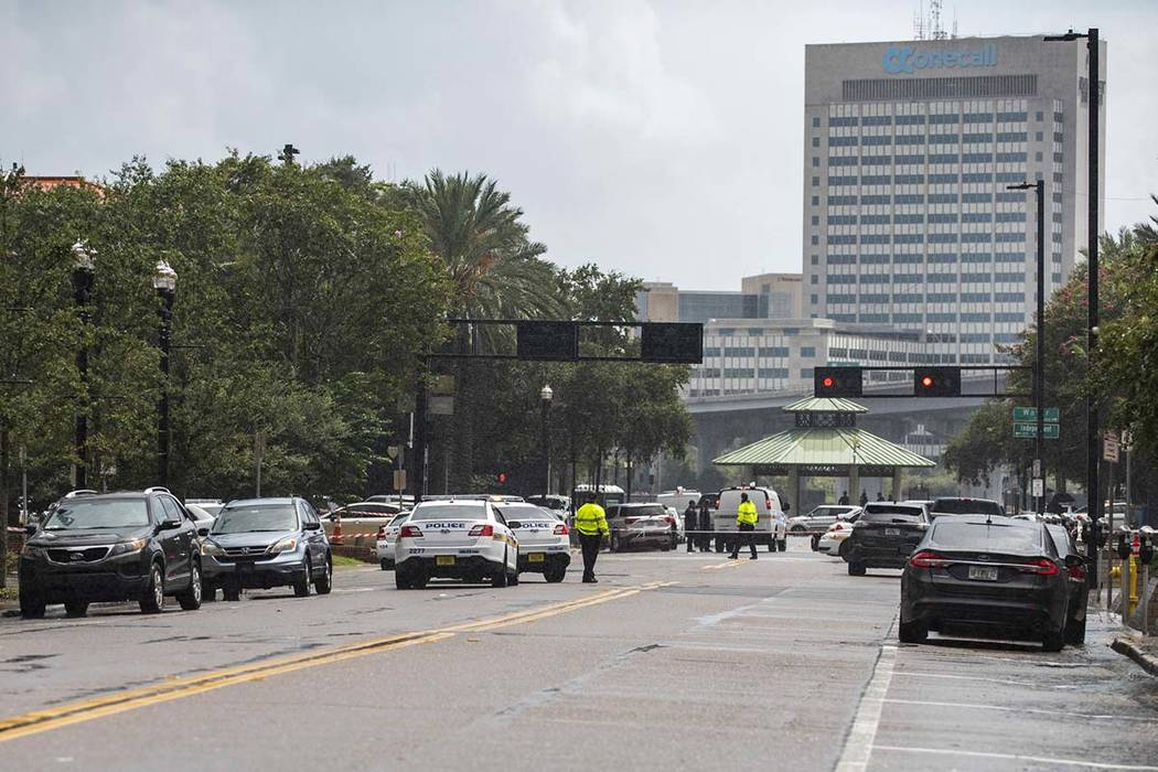 Police barricade a street near Jacksonville Landing in Jacksonville, Fla., Sunday, Aug. 26, 2018. Florida authorities are reporting multiple fatalities after a mass shooting at the riverfront mall ...