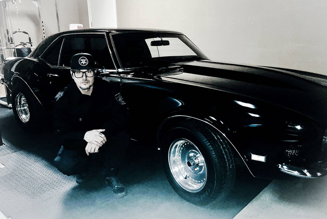 "Zak Bagans of ""Ghost Adventurers"" on Travel Channel and owner of Zak Bagans' Haunted Museum, is shown in his Las Vegas home with the 1968 Camaro once owned by Branch Davidian leader David Koresh. ..."
