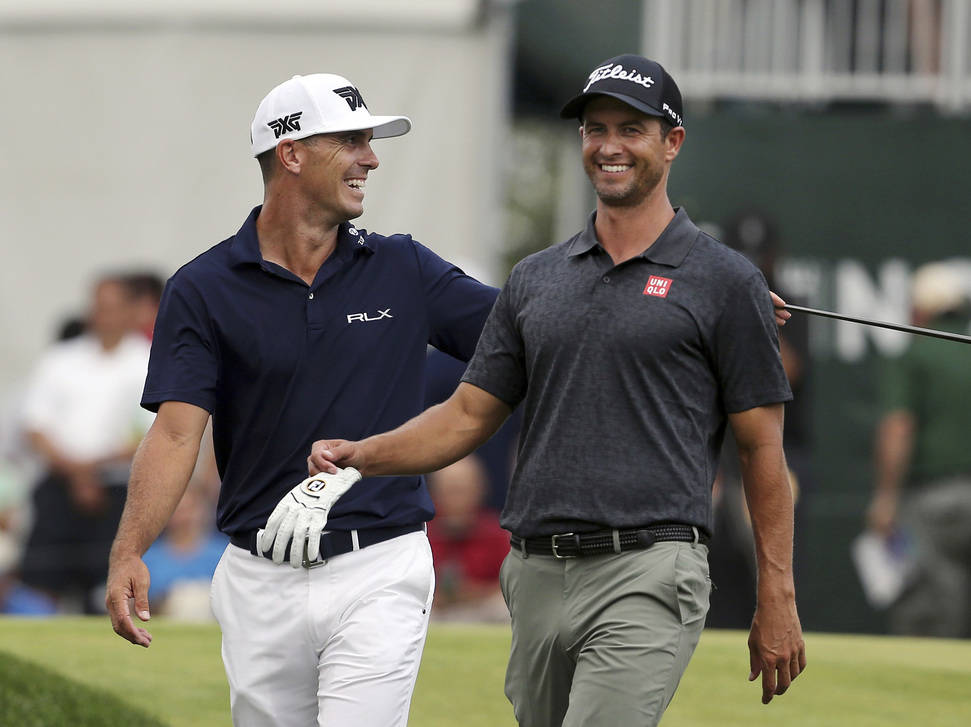 Billy Horschel, left laughs with Adam Scott, of Australia, as they walk on the 17th hole during the final round of the Northern Trust golf tournament Sunday, Aug. 26, 2018, in Paramus, N.J. Bryson ...