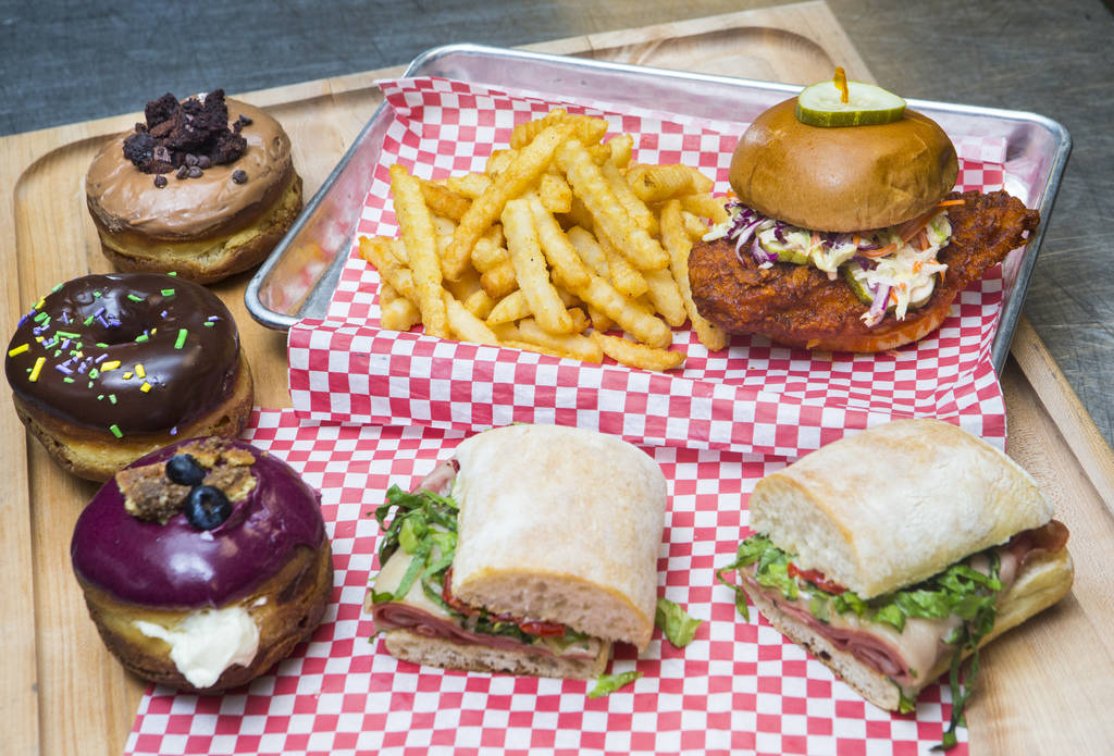 Donuts from District: Donuts. Sliders. Brew, left, the hot chicken sandwich from Hattie B's, above, and grilled mortadella sandwich from Lardo at The Cosmopolitan of Las Vegas in Las Vegas on Frid ...