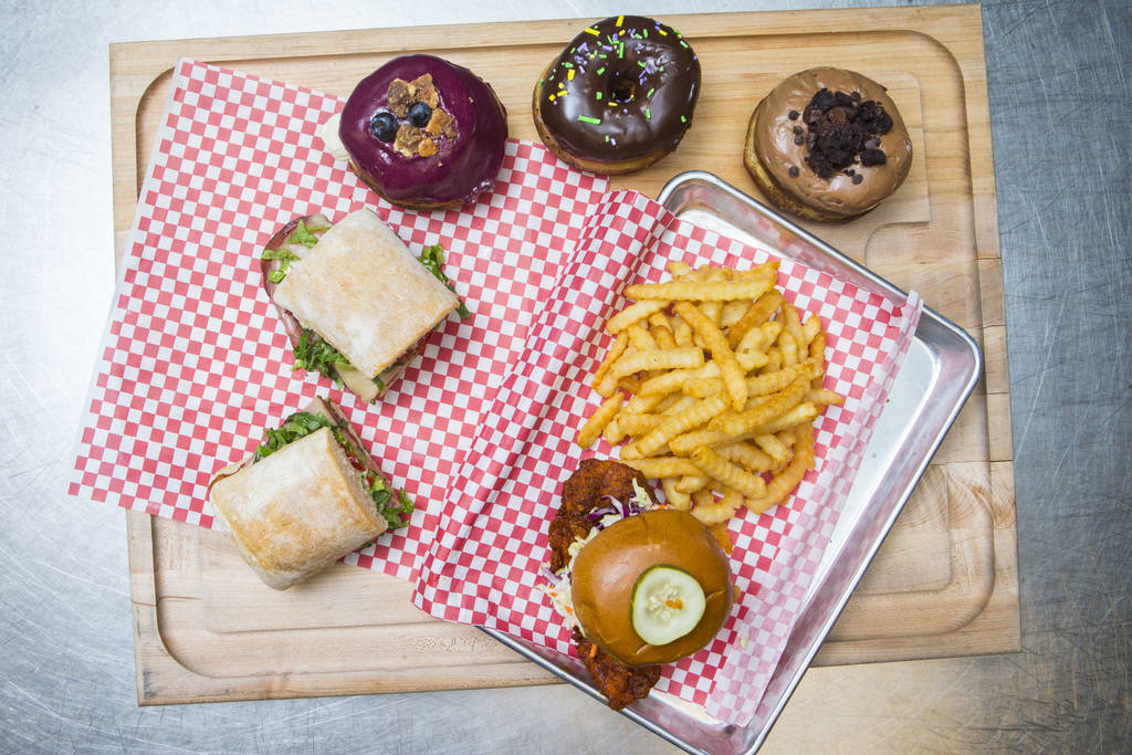 Grilled mortadella sandwich from Lardo, from left, donuts from District: Donuts. Sliders. Brew, above, and the hot chicken sandwich from Hattie B's at The Cosmopolitan of Las Vegas in Las Vegas on ...