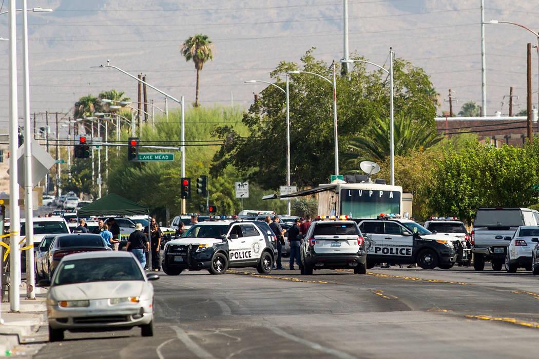 Las Vegas police investigate an officer-involved shooting at Doolittle Avenue near H Street in Las Vegas on Saturday, Aug. 25, 2018. (Chase Stevens/Las Vegas Review-Journal) @csstevensphoto