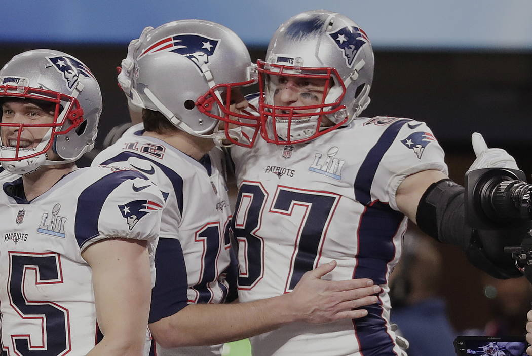 New England Patriots quarterback Tom Brady (12) and tight end Rob Gronkowski (87) celebrate a touchdown, during the second half of the NFL Super Bowl 52 football game against the Philadelphia Eagl ...