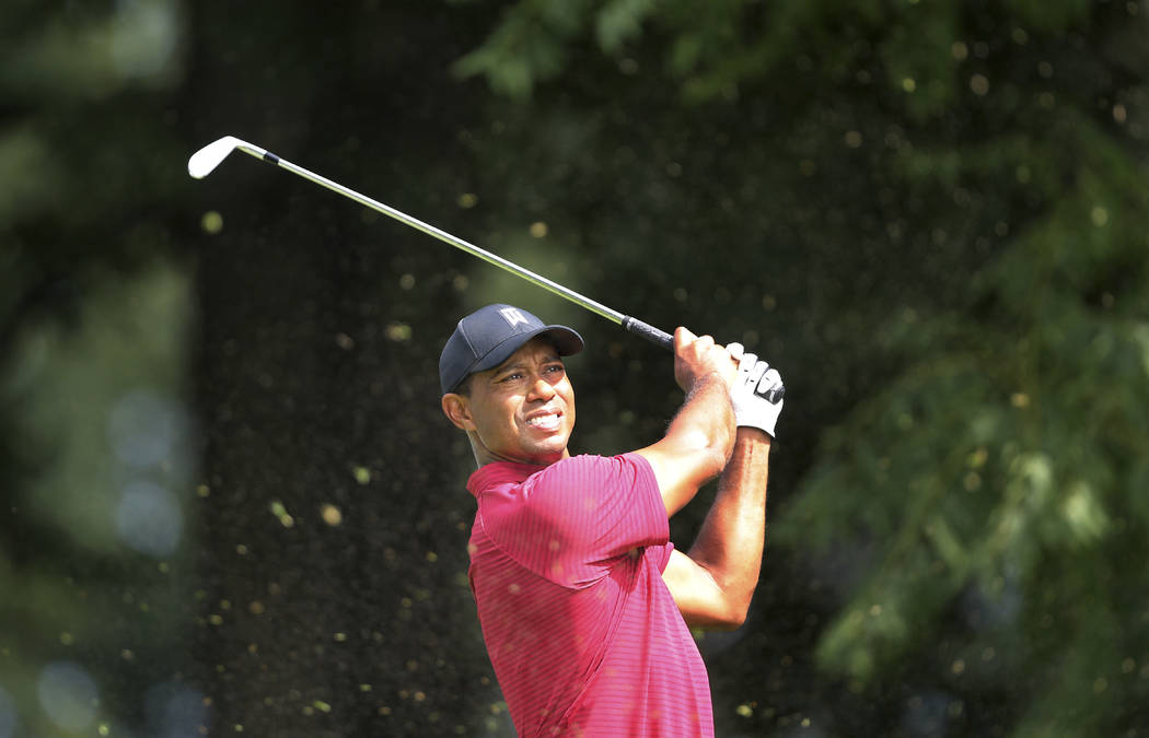 Tiger Woods watches his shot on the sixth hole during the final round of the Northern Trust golf tournament, Sunday, Aug. 26, 2018, in Paramus, N.J. (AP Photo/Mel Evans)