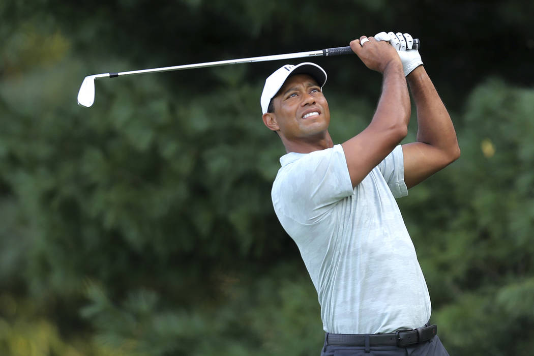 Tiger Woods hits a tee shot on the second hole during the third round of the Northern Trust golf tournament, Saturday, August 25, 2018, in Paramus, N.J. (AP Photo/Mel Evans)