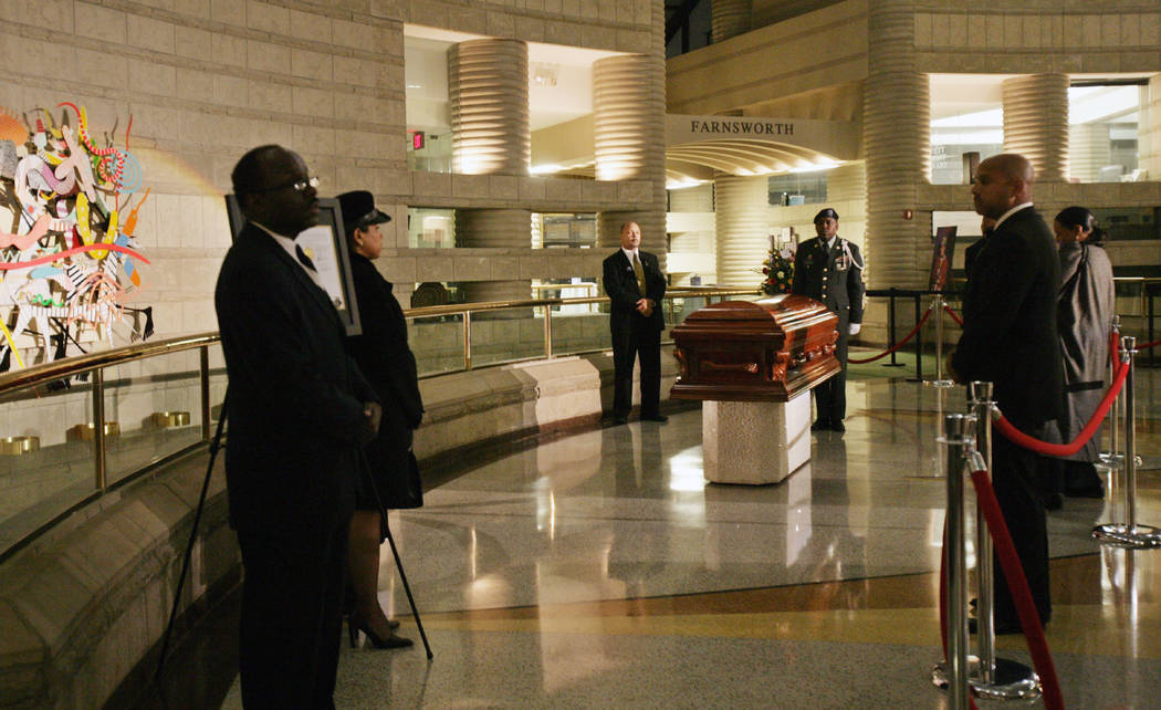 In this Oct. 31, 2005 file photo, Rosa Parks coffin lies in the Charles H. Wright Museum of African American History in Detroit. Aretha Franklin will lie at the museum for two days before her fune ...