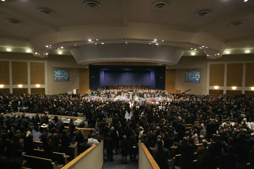 In this Nov. 2, 2005 file photo, people attend the funeral for Rosa Parks at the Greater Grace Temple in Detroit. Aretha Franklin's funeral will be held at Greater Grace Temple in Detroit Friday, ...