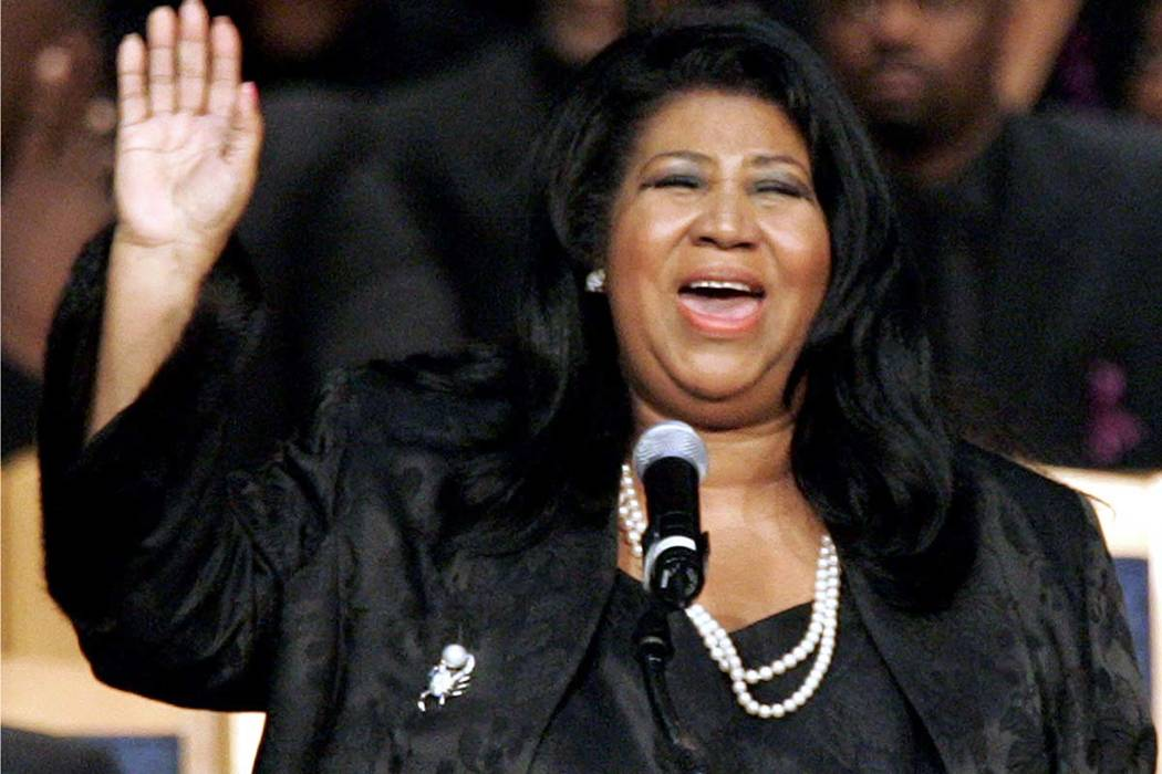 In this Nov. 2, 2005 file photo, Aretha Franklin sings during the funeral for civil rights pioneer Rosa Parks at the Greater Grace Temple in Detroit. Franklin died Aug. 16, 2018, of pancreatic can ...