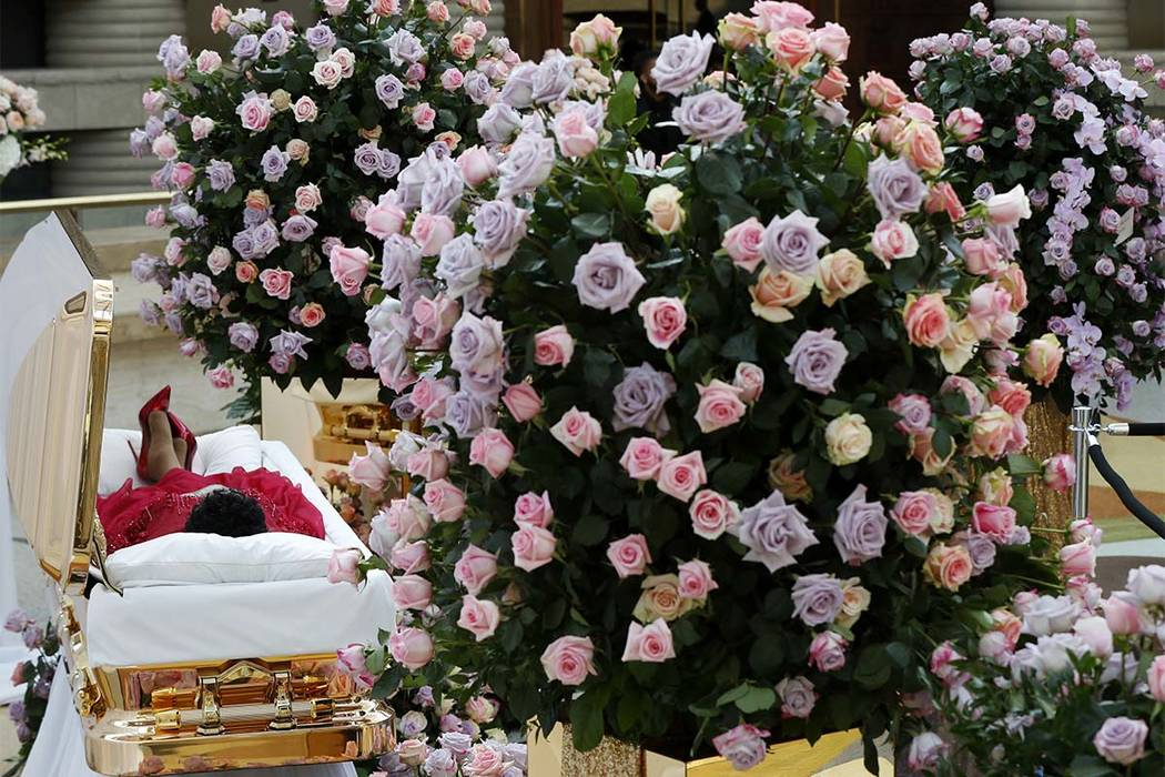 Aretha Franklin lies in her casket at Charles H. Wright Museum of African American History during a public visitation in Detroit, Tuesday, Aug. 28, 2018. Franklin died Aug. 16, 2018, of pancreatic ...