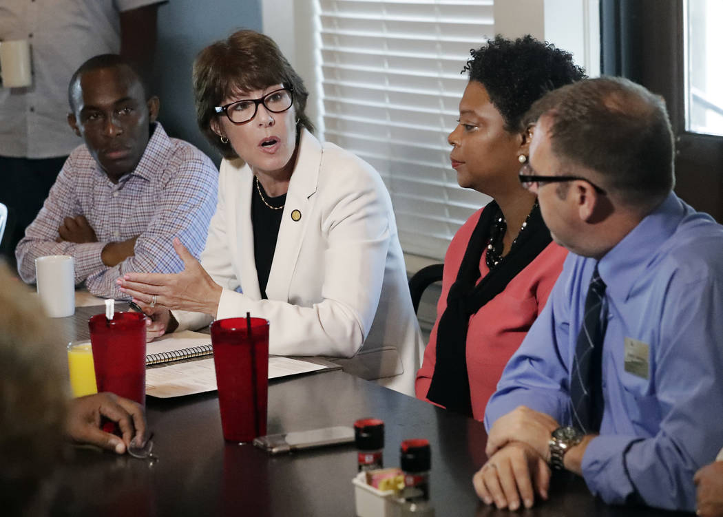 Florida Democratic gubernatorial candidate Gwen Graham, second from left, speaks with Jacksonville community leaders about gun violence Monday, Aug. 27, 2018, at a restaurant near the scene of a m ...