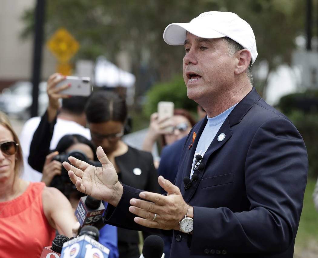 Florida Democratic gubernatorial candidate Philip Levine talks to members of the media Monday, Aug. 27, 2018, near the scene of a mass shooting at The Jacksonville Landing in Jacksonville, Fla. A ...