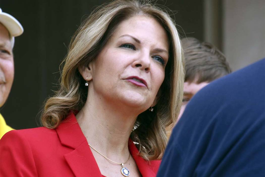 Arizona Republican U.S. Senate candidate Kelli Ward speaks to the media on May 2, 2018, as she prepares to file her nominating petitions at the state Capitol in Phoenix. Ward, running for her part ...
