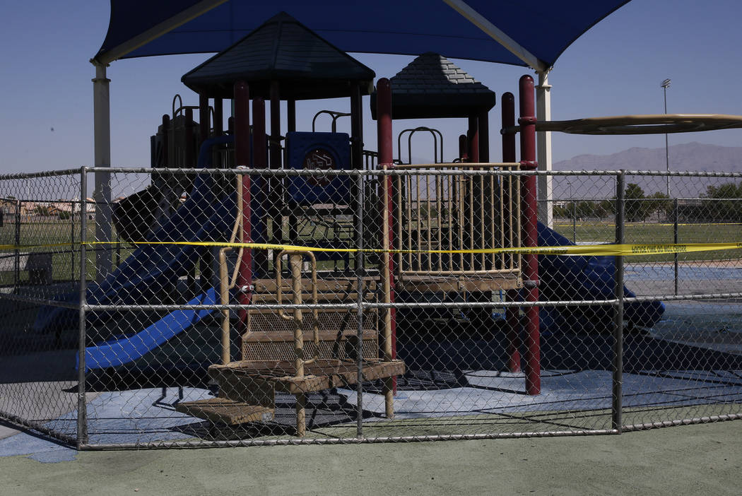 A playground at Bettye Wilson Soccer Complex is fenced off as Las Vegas firefighters investigate a fire at West Lake Mead Boulevard and North Tenaya Way, early Tuesday, Aug. 28, 2018, in Las Vegas ...
