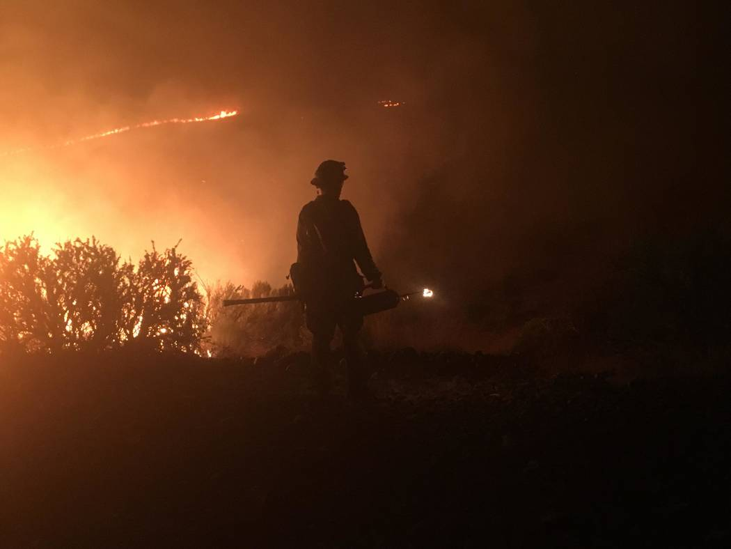 A firefighter works on the South Sugarloaf Fire in northern Elko County on Thursday. U.S. Forest Service