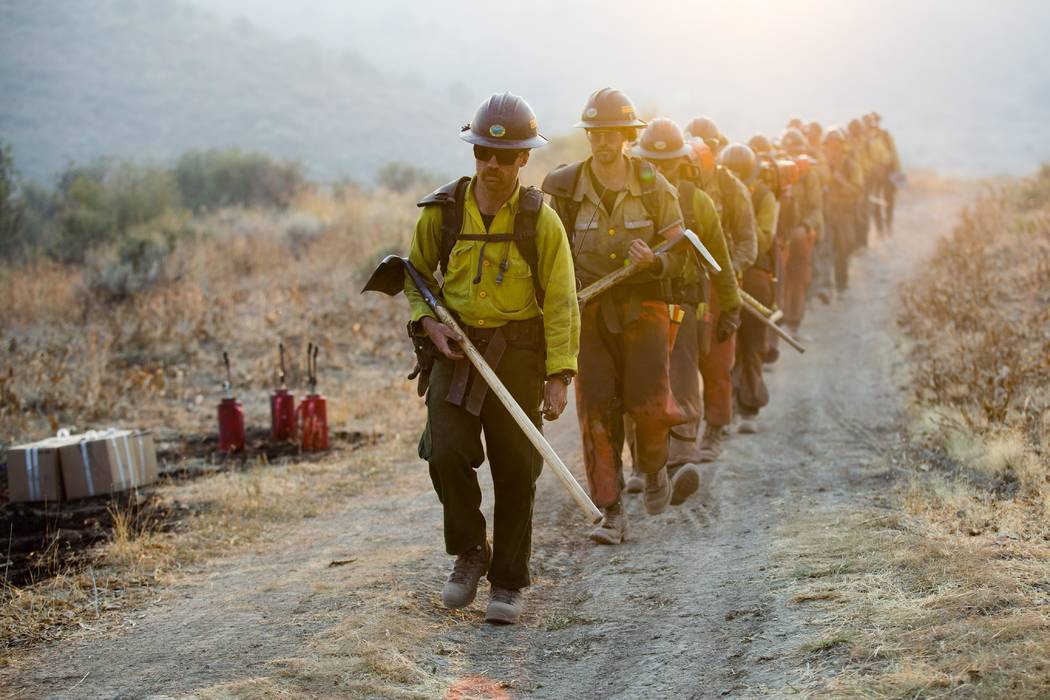 Firefighters walks along a road while fighting the South Sugarloaf Fire in Northeastern Nevada Friday. U.S. Forest Service