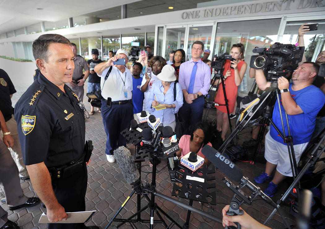 Jacksonville Sheriff Mike Williams addresses the media across the street from the scene of a multiple shooting at The Jacksonville Landing during a video game tournament, Sunday, Aug. 26, 2018, in ...