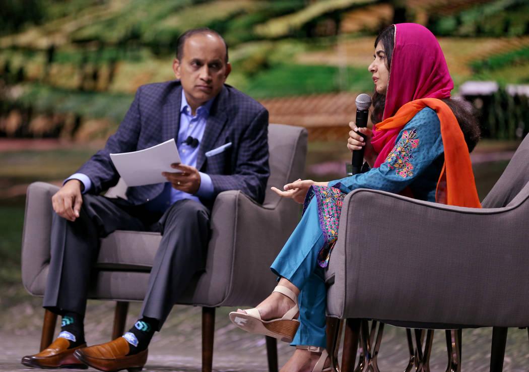 Nobel Peace Prize winner Malala Yousafzai speaks with VMware Chief Operating Officer Sanjay Poonen at VMworld 2018 at Mandalay Bay Tuesday, Aug. 28, 2018. K.M. Cannon Las Vegas Review-Journal @KMC ...