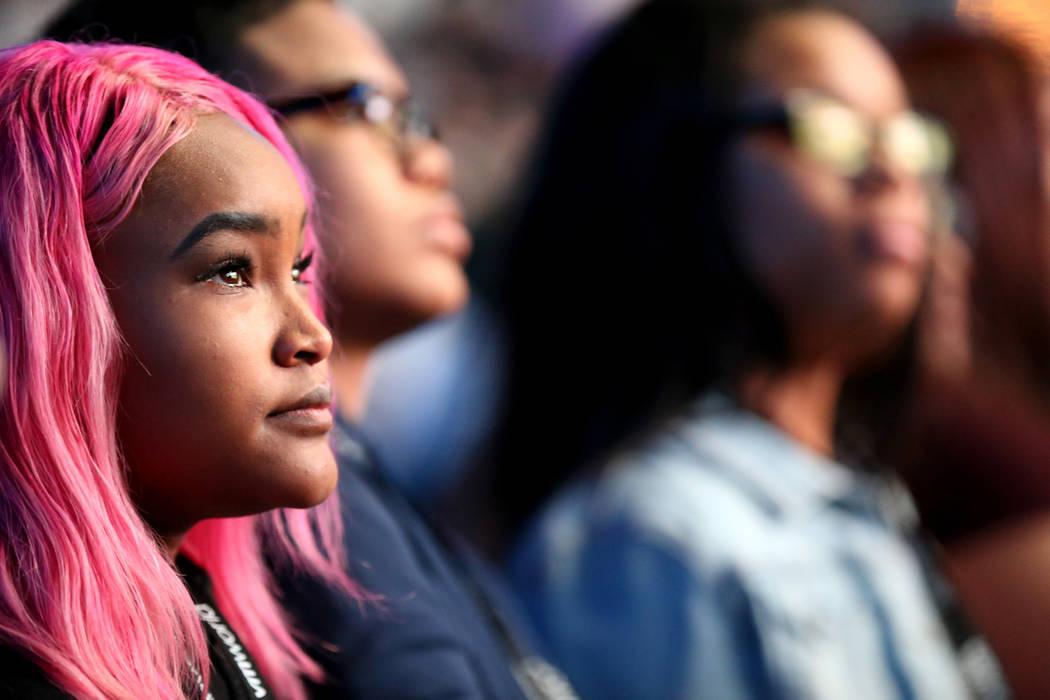 Students at Legacy and Basic high schools, including Legacy senior Natique Simmons Ellison, left, listen as Nobel Peace Prize winner Malala Yousafzai speaks at VMworld 2018 at Mandalay Bay Tuesday ...