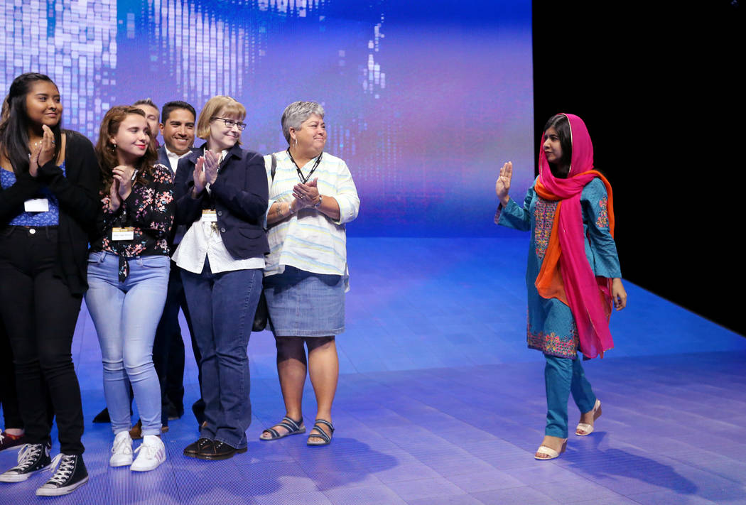 Nobel Peace Prize winner Malala Yousafzai steps on the stage to take a photo with students from Basic High School at VMworld 2018 at Mandalay Bay Tuesday, Aug. 28, 2018. K.M. Cannon Las Vegas Revi ...