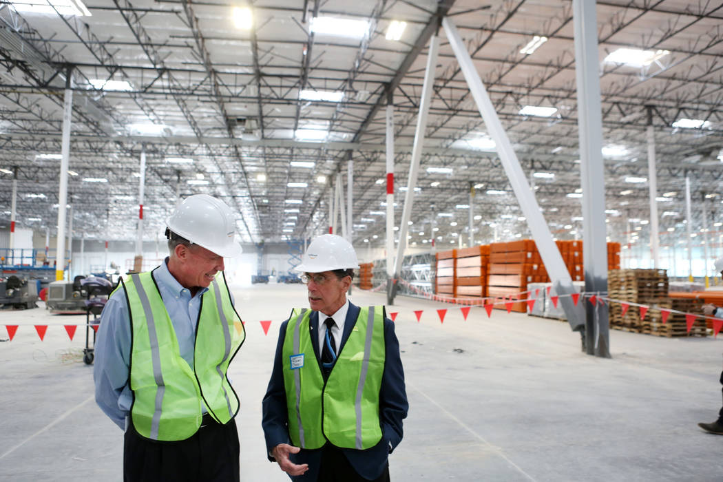 Keith Earnest, executive vice president of VanTrust Real Estate LLC, left, and North Las Vegas Councilman Richard Cherchio speak during a tour given of the newest Amazon warehouse that is under co ...