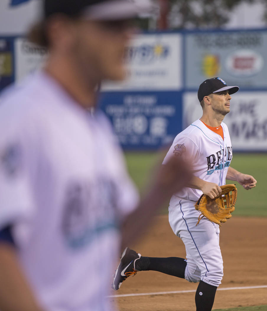 51s third baseman David Wright, right, runs off the field during Las Vegas' home matchup with the Tacoma Rainiers on Tuesday, Aug. 28, 2018, at Cashman Field, in Las Vegas. Wright hasn't pl ...