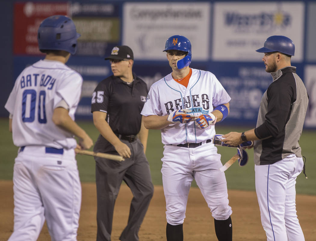 51s third baseman David Wright, middle, looks at a piece of his bat that shattered after he singled to right field during Las Vegas' home matchup with the Tacoma Rainiers on Tuesday, Aug. 28, 201 ...