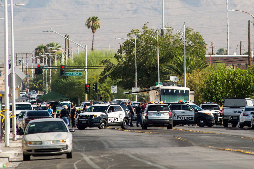 Las Vegas police investigate an officer-involved shooting at Doolittle Avenue near H Street in Las Vegas on Saturday, Aug. 25, 2018. Chase Stevens Las Vegas Review-Journal @csstevensphoto