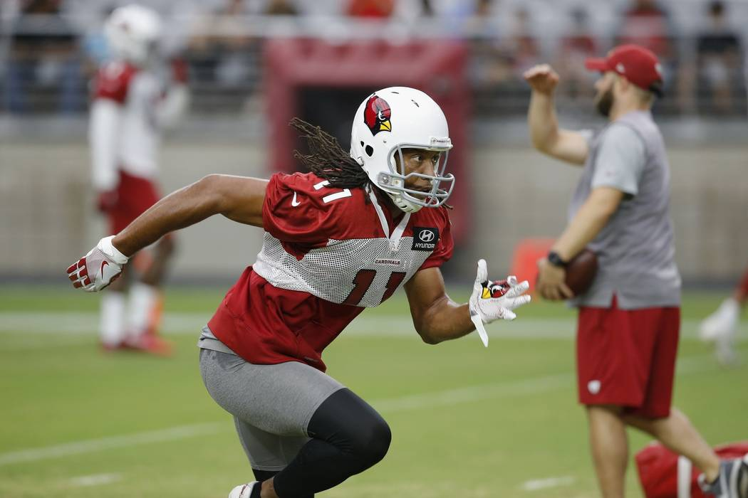 Arizona Cardinals wide receiver Larry Fitzgerald runs out for a pass during an NFL football practice Monday, Aug. 13, 2018, in Glendale, Ariz. (AP Photo/Ross D. Franklin)