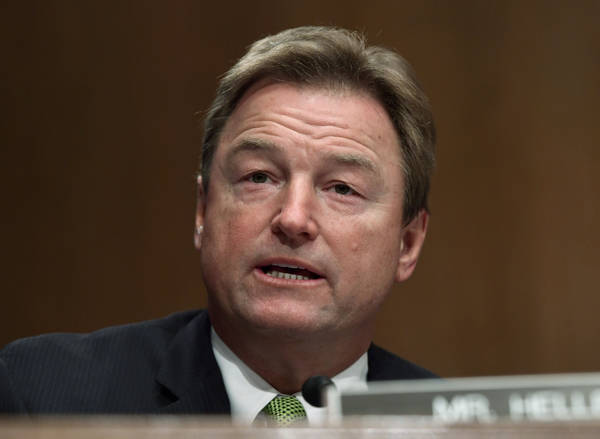 In this Jan. 30, 2018, file photo, Sen. Dean Heller, R-Nev., asks a question during a Senate Banking Committee hearing on Capitol Hill in Washington. (AP Photo/Susan Walsh, file)