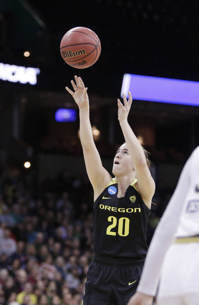 Oregon guard Sabrina Ionescu (20) shoots during the first half in a regional final at the NCAA women's college basketball tournament against Notre Dame, Monday, March 26, 2018, Spokane, Wash. (AP ...