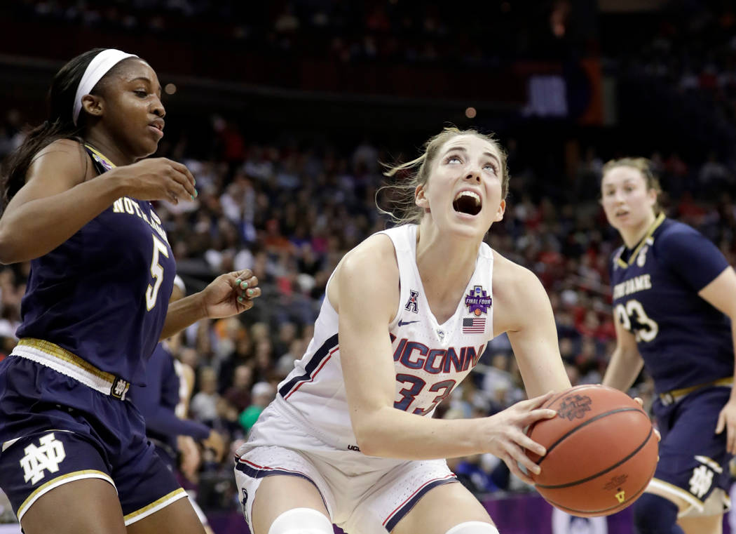 Connecticut's Katie Lou Samuelson (33) heads to the basket as Notre Dame's Jackie Young watches during the first half in the semifinals of the women's NCAA Final Four college basketball tournament ...