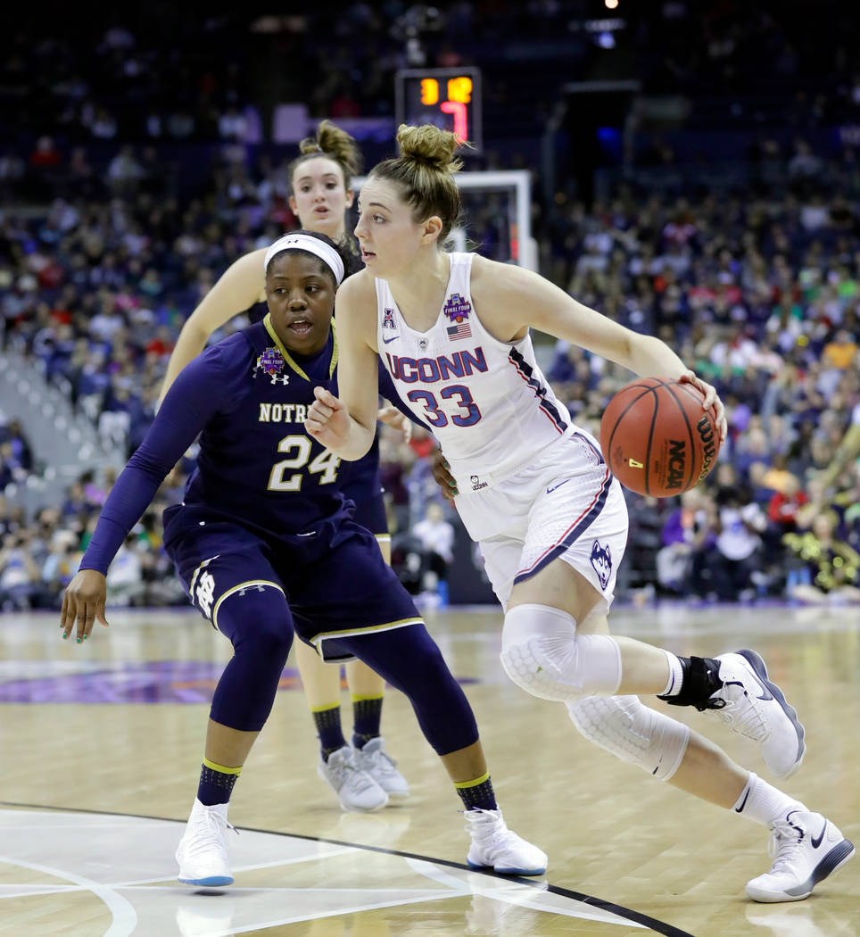 Connecticut's Katie Lou Samuelson (33) goes to the basket against Notre Dame's Arike Ogunbowale (24) during the second half in the semifinals of the women's NCAA Final Four college basketball tour ...