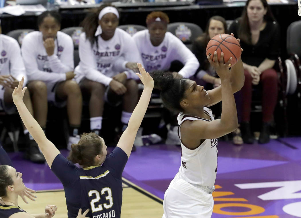 Mississippi State's Teaira McCowan, right, misses a shot as Notre Dame's Jessica Shepard (23) watches late in the second half in the final of the women's NCAA Final Four college basketball tournam ...