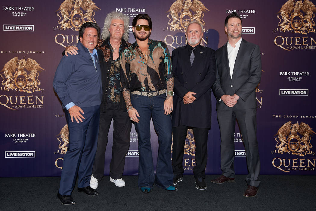 MGM Resorts President Bill Hornbuckle, Brian May, Adam Lambert, Roger Taylor and Live Nation executive Kurt Melien, from left, are shown at MGM Resorts Aviation Hangar in Las Vegas during an annou ...