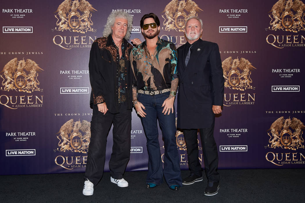 """Brian May, Adam Lambert, and Roger Taylor, from left, are shown at MGM Resorts Aviation Hangar in Las Vegas during an announcement of Queen + Adam Lambert """"The Crown Jewels"""" residency at Park Thea ..."""