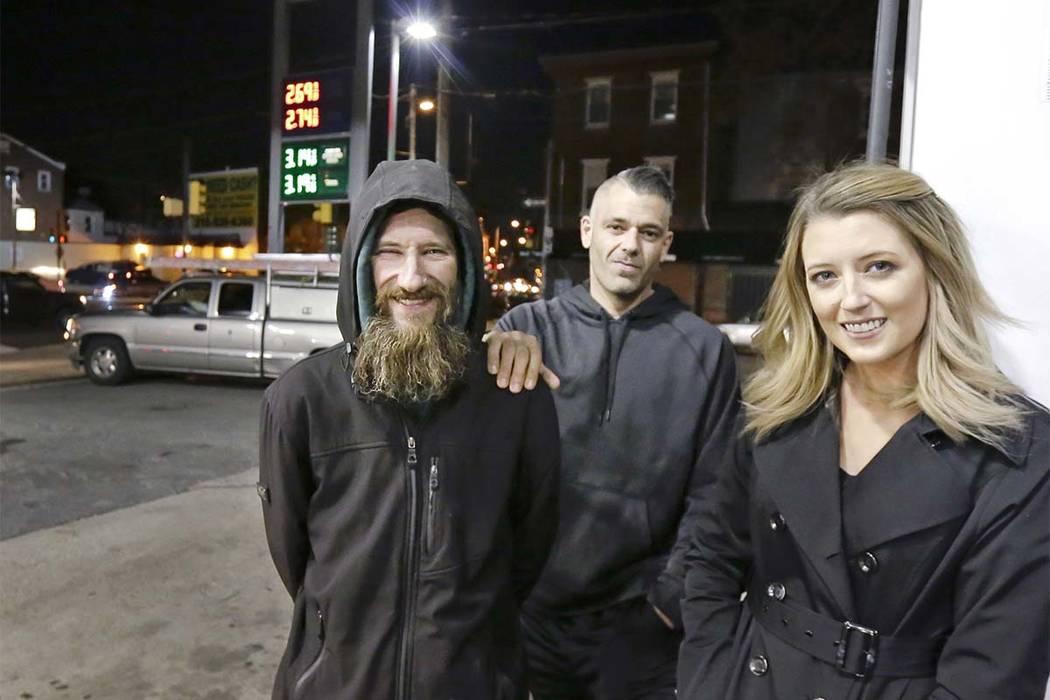 In this Nov. 17, 2017 file photo, Johnny Bobbitt Jr., left, Kate McClure, right, and McClure's boyfriend Mark D'Amico pose at a Citgo station in Philadelphia. (Elizabeth Robertson/The Philadelphia ...