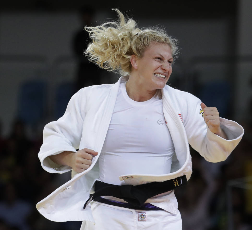 In this Aug. 11, 2016, file photo, United States' Kayla Harrison celebrates after winning the gold medal of the women's 78-kg judo competition at the 2016 Summer Olympics in Rio de Janeiro, Brazil ...
