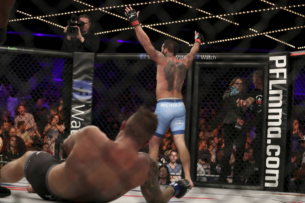 In this June 7, 2018, file photo, Alex Nicholson celebrates a KO against Jake Heun after their mixed martial arts bout at PFL 1, at Madison Square Garden in New York. (AP Photo/Gregory Payan, File)