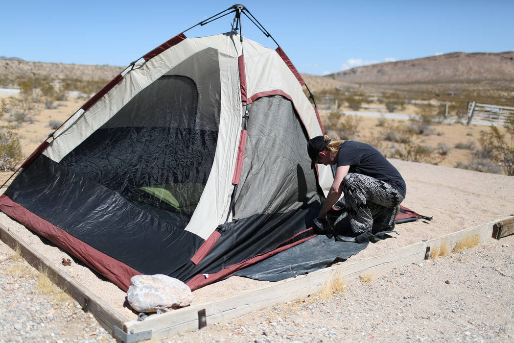 Tara Charter, 53, zips up her tent at Red Rock Canyon Campground in Las Vegas on Friday, Sept. 2, 2016. The campground, very popular with rock climbers, opened Friday and will be open through Memo ...