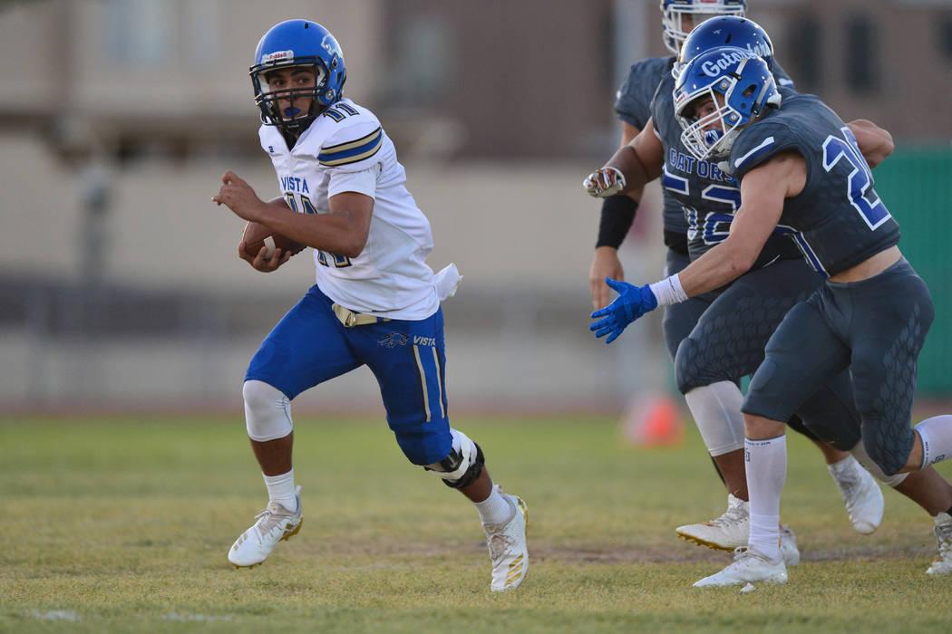 Sierra Vista quarterback Jordan Solomon (11) runs the ball for a touchdown against Green Valley High School in the first quarter at Green Valley High School in Henderson on Friday, Aug. 31, 2018. ...