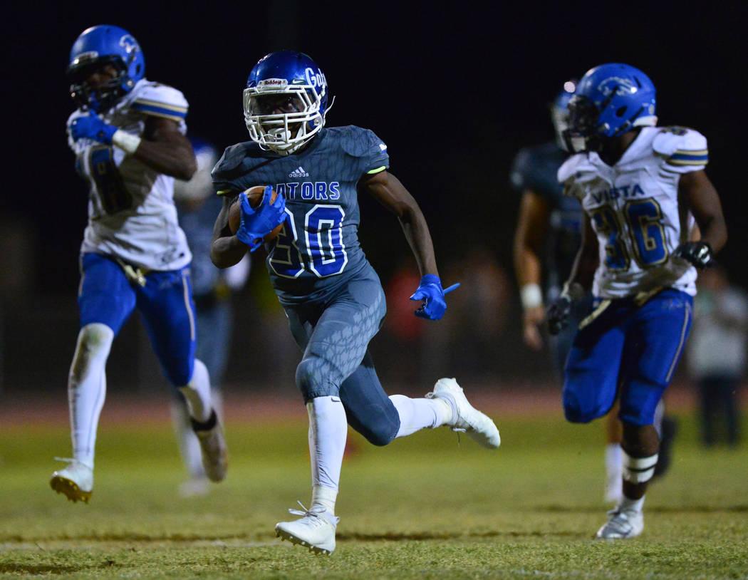 Green Valley running back Maaliek Duncan (30) runs the ball for a touchdown against Sierra Vista High School at Green Valley High School in Henderson on Friday, Aug. 31, 2018. Green Valley won 26- ...