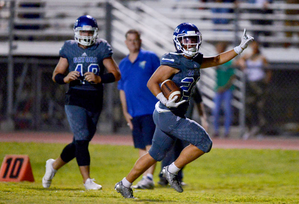 Green Valley running back Noah Hawthorne (22) scores the winning touchdown in the fourth quarter against Sierra Vista High School at Green Valley High School in Henderson on Friday, Aug. 31, 2018. ...